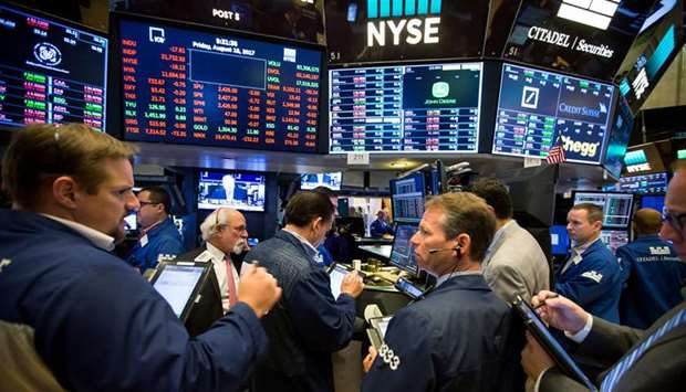 Traders work on the floor of the New York Stock Exchange (file). US stock valuations are tumbling in
