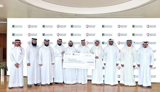 Doha Bank and Qatar Charity officials during the ceremonial handing over of the QR2mn cheque