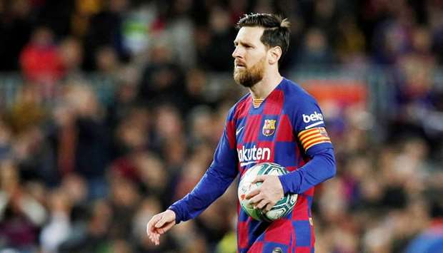 Captain Lionel Messi and his Barcelona teammates are in discussions with the club over a pay cut. (R