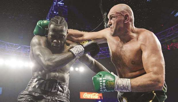 Deontay Wilder (left) and Tyson Fury box during their WBC heavyweight title bout at MGM Grand Garden