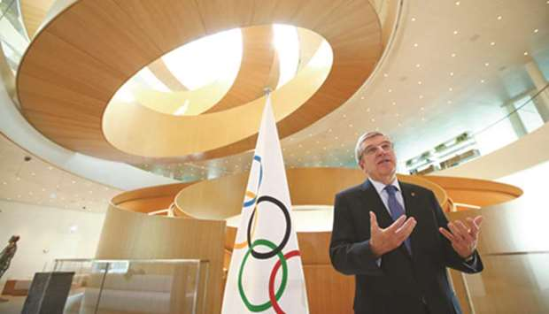 International Olympic Committee President Thomas Bach speaks after the historic decision to postpone