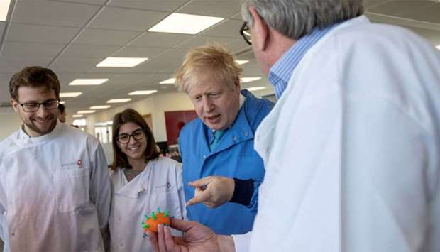 (FILE PHOTO) Britain's Prime Minister Boris Johnson visits the Mologic Laboratory