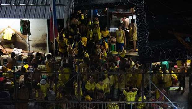 This photo shows prison inmates at the crowded courtyard of the Quezon City jail in Manila.