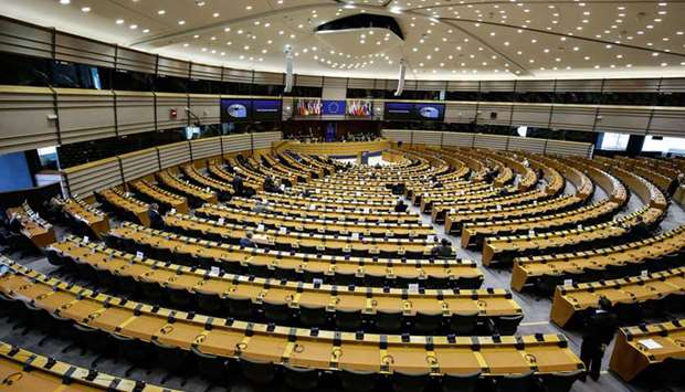 Members of the European Parliament attend a mini plenary session in Brussels yesterday. Due to the c