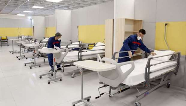 Iranian workers setting up a makeshift hospital inside the Iran Mall, northwest of Tehran, amid the