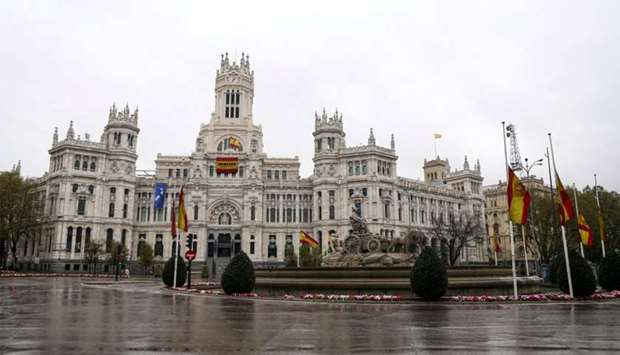 The Spanish flag flutters at half mast at Madrid's City Hall, during the coronavirus disease (COVID-