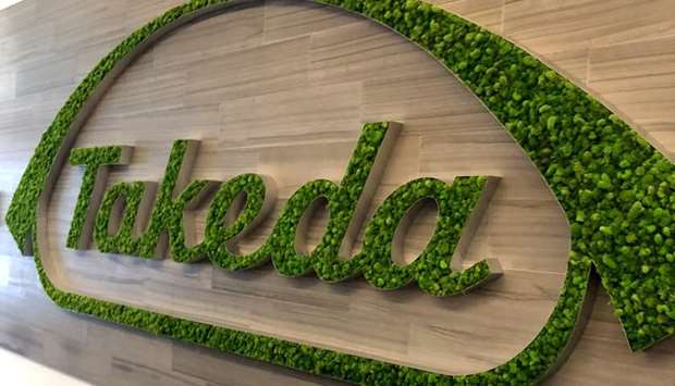 Takeda logo is seen in its research hub in Cambridge, Massachusetts, US, November 26, 2018