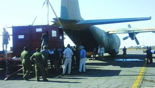Containers for black rhinos stand prior to loading onto a plane in an African country. Aviation indu