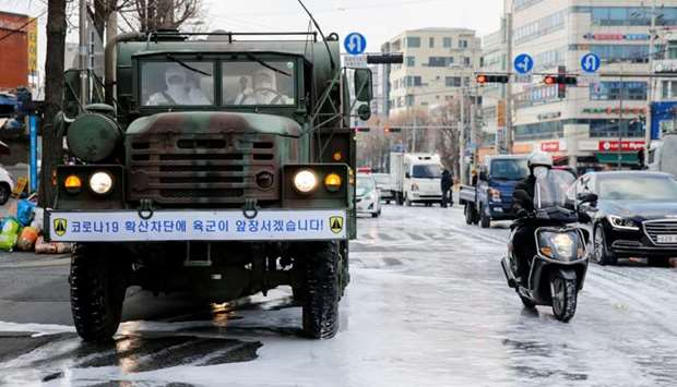 A military vehicle disinfects a road to prevent the spread of coronavirus in Seoul, South Korea