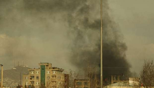 Smoke rises from the site of a gun attack following an attack in Kabul
