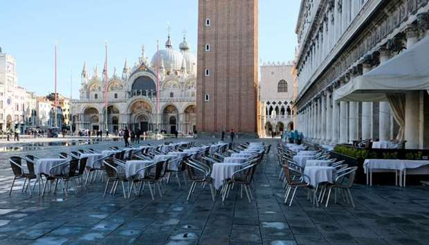 Empty restaurant tables are seen in St. Mark's Square as the Italian government prepares to adopt ne