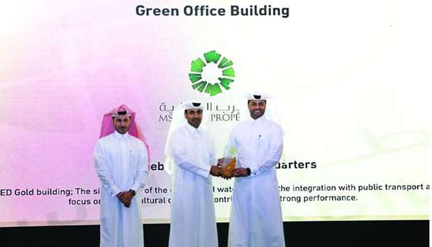 "Msheireb Properties officials receiving the ""Green Office Building Award""."