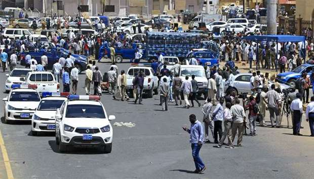 Sudanese rescue teams and security forces gather at the site of an assassination attempt against Sud