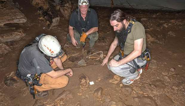 French geo-archeologist Richard Oslisly (C) and two French anthropo-biologists Sebastien Villotte (L