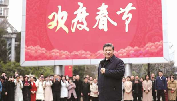 Chinese President Xi Jinping talks to local residents in Guanshanhu District of Guiyang. For US poli