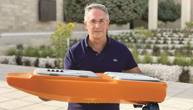 Gianni Di Caro with one of the relatively small aerial and marine robots used as part of the initiat
