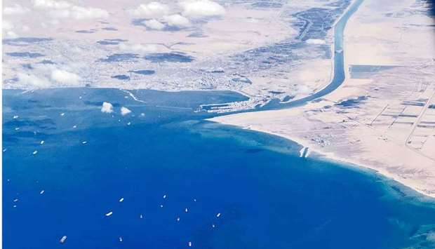 stranded ships waiting in queue in the Gulf of Suez to cross the Suez Canal at its southern entrance