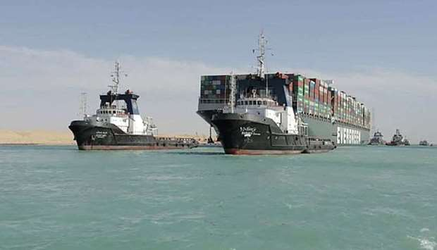 A picture released by Egypt's Suez Canal Authority on March 29, 2021, shows a tugboat pulling the Pa