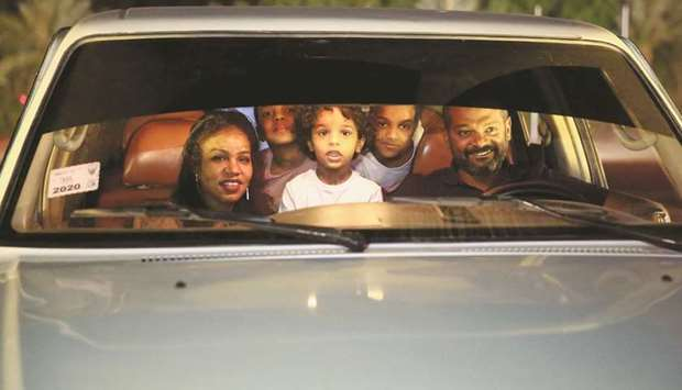 People are seen through their car window as they watch a screening of the Sudanese European Film Fes