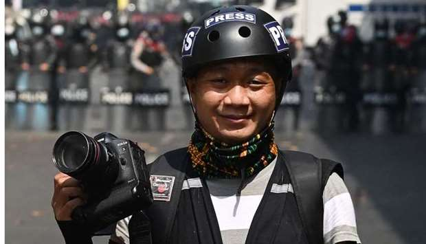 This picture taken on February 26 shows Associated Press photographer Thein Zaw posing for a photo d