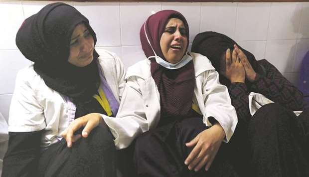 File photo shows colleagues of Palestinian nurse Razan al-Najar, who was killed during a protest at