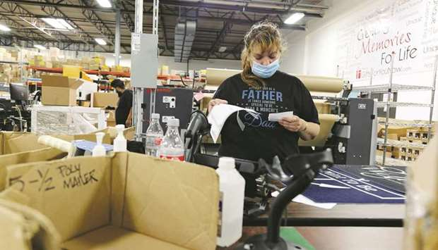 An employee reviews paperwork at the Gifts For You company warehouse in Woodridge, Illinois. US econ
