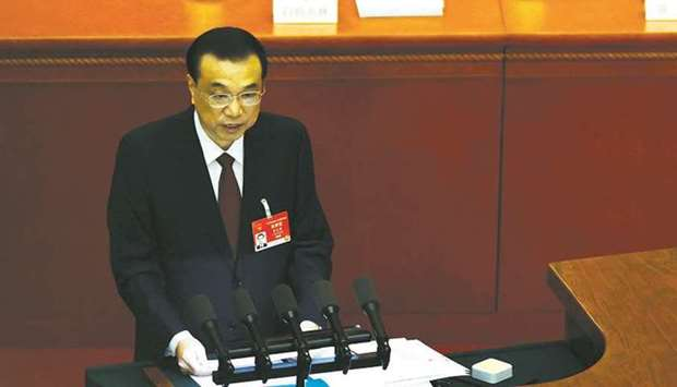 Chinese premier Li Keqiang speaks at the opening session of the National People's Congress (NPC) at