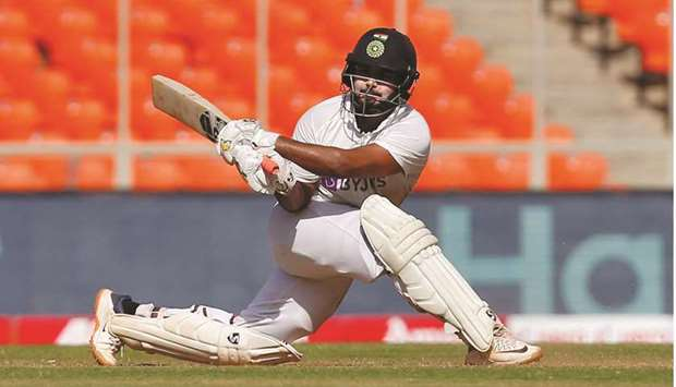 India's Rishabh Pant plays a sweep shot en route to his 101 against England in the fourth Test in Ah