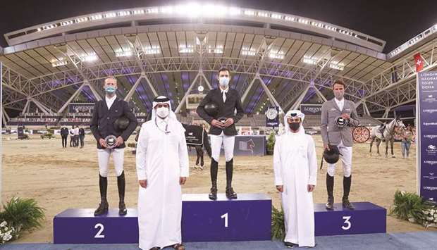 Asian and Qatar Equestrian Federation president Hamad bin Abdulrahman al-Attiyah (second left) and L