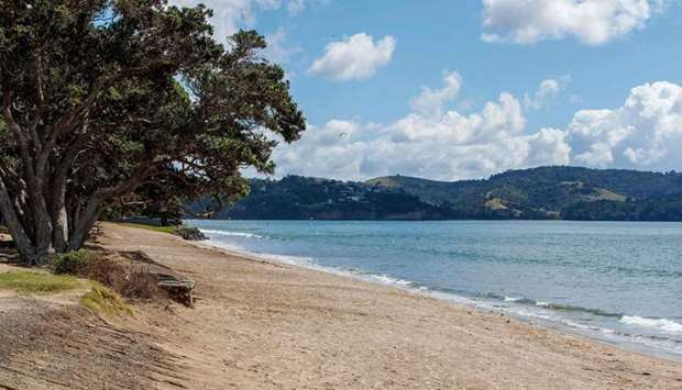 A deserted beach is pictured following a tsunami warning in Orewa, north of Auckland