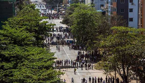 Protesters form lines as they take part in a demonstration against the military coup in Yangon