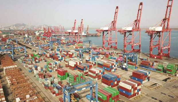 This aerial photo shows shipping containers for export stacked at a port in Lianyungang. China's Feb