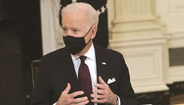 US President Joe Biden speaks during a roundtable meeting at the White House in Washington, DC on Ma