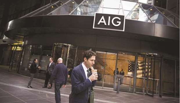 Pedestrians walk past the American International Group (AIG) headquarters in New York. The market fo