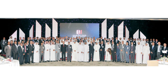 Qatar Steel officials, dignitaries, traders and distributors at the event.