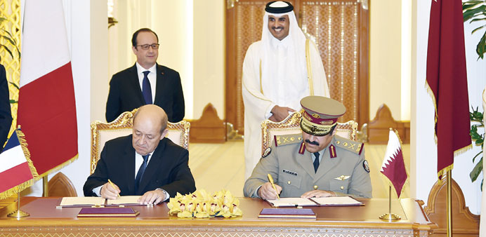 HH the Emir Sheikh Tamim  and President Hollande witnessing the signing of an agreement yesterday.