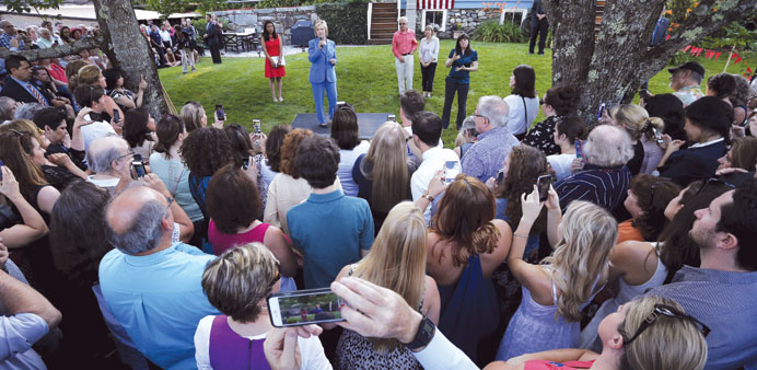 Clinton speaks during a campaign stop in a backyard of a home in Windham, New Hampshire on Thursday.