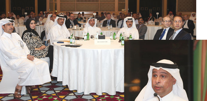 Participants at the first ERM Forum at The Ritz-Carlton Doha.  Issa Shahin al-Ghanim speaking at