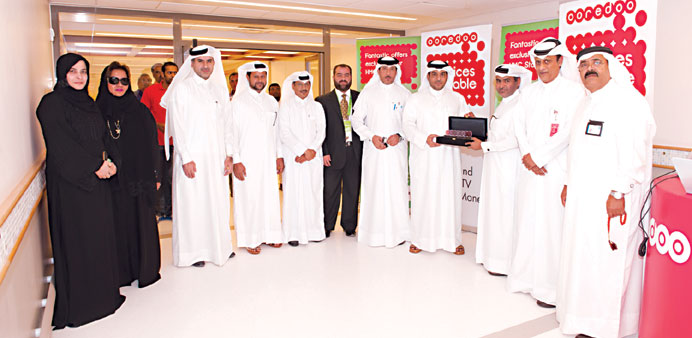 Ooredoo and HMC officials at the ceremony.