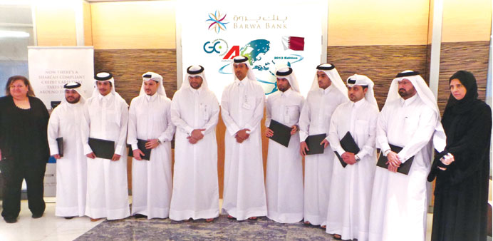The Barwa Bank management team after receiving the award.