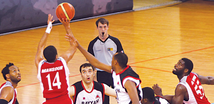 Al Rayyan and Al Arabi players in action during their Heir Apparent Cup basketball match on Tuesday.
