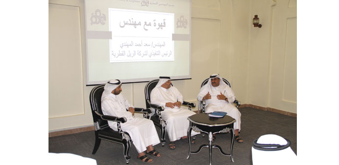Al-Muhannadi (centre) with al-Jolo (right) at the QSE headquarters.