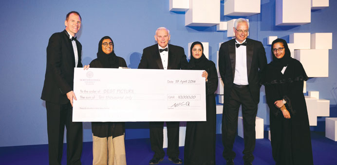 The winning filmmaker in the Best Picture category with NU-Q and Thimun Qatar officials.