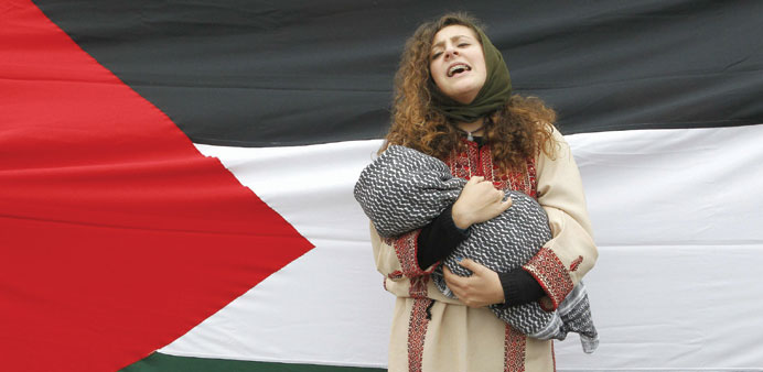 A member of the Palestine community during a rally in Valparaiso, northwest of Santiago.
