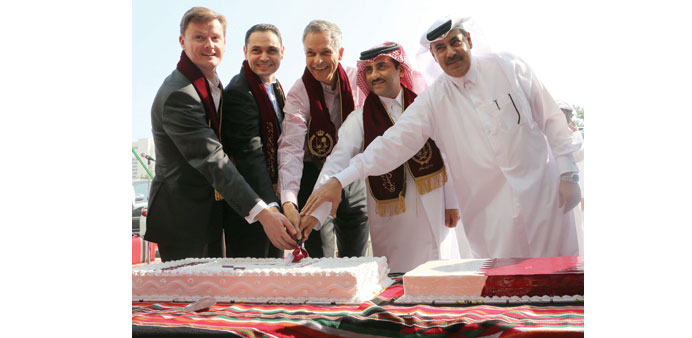 Officials cutting a cake on the occasion.