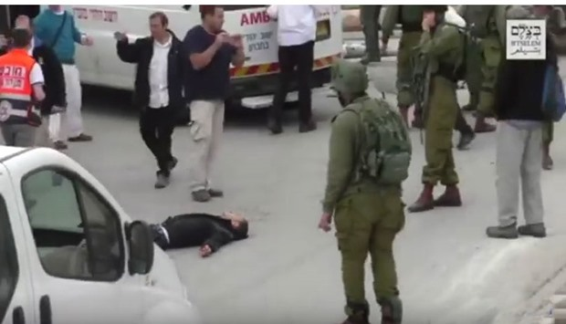 An image grab from a video that shows Abdul Fatah al-Sharif, the Palestinian who was shot, lying on