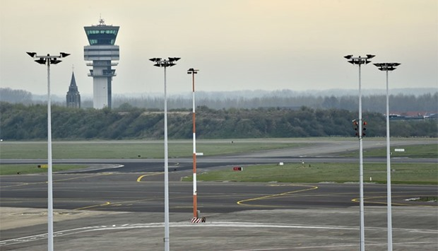 The control tower and an empty tarmac are pictured at the Brussels Airport