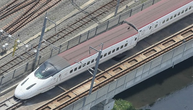 An aerial view shows a derailed Kyushu shinkansen, or bullet train, in the city of Kumamoto
