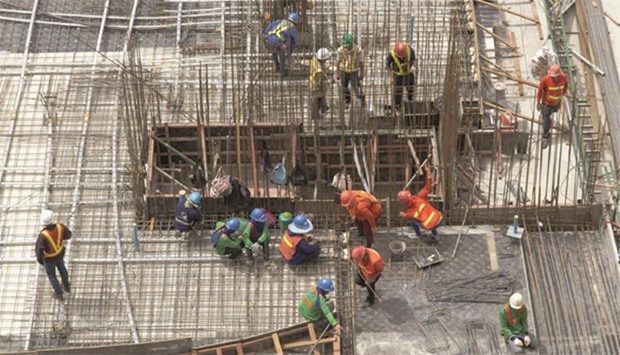 Workers at a construction project in Doha