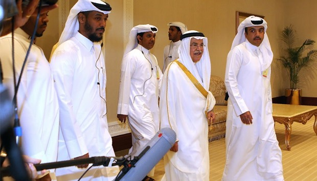 Saudi Arabia's minister of Oil and Mineral Resources Ali al-Naimi (C) arrives for Doha meeting